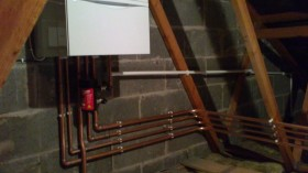 Example of pipework prior to insulating. It also shows a MagnaClean which helps keep your system clean and efficient