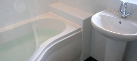 Curved quadrant bathroom suite expertly fitted by Aqua Systems
