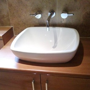 Designer sink basin with wall mounted taps
